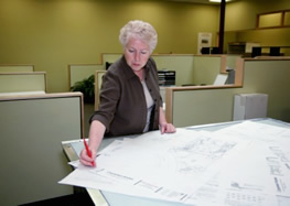 Woman reading blueprints